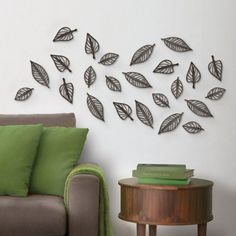 #walldecor Save 21%  Bring your home to life with this large set of 24 moulded plastic espresso colour leaves that can be individually placed however you like to create a unique feature wall or movement in any room!