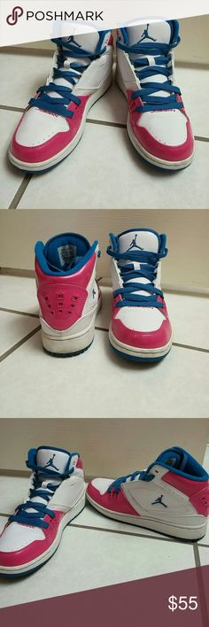 Nike Jordan Sneakers Pink, blue, and white Jordan Sneakers. They are still  in