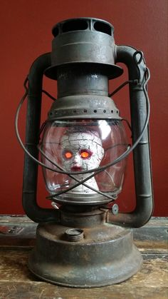 "One-of-a-kind Upcycled Repurposed ""Rebekah's Been Railroaded"" Creepy Doll Head Steampunk Art Vintage Dietz Lantern Lamp w/Night Light Bulb by UrsMineNours on Etsy https://www.etsy.com/listing/469430987/one-of-a-kind-upcycled-repurposed"