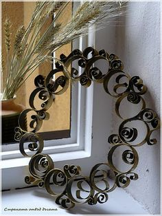 Wrought Iron Looking Wreath - maybe use cardboard and paint to look metallic/weathered