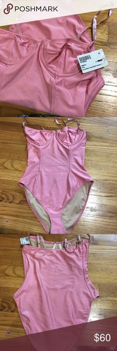 Light pink vintage style bathing suit. BRAND NEW NEVER WORN. A few dirt/ dust marks from the closet. American Apparel Swim