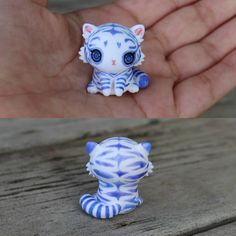 This little companion is a white tiger cub figurine. It has been entirely sculpted from scratch and has been painted freehand with powdery cornflower blue stripes for a fantasy effect. The eyes have been domed to give them dimension and make them more realistic. You will recieve the exact cub from the picture and I hope you love this little guy as much as I do :)  It will come glazed and carefully packaged!  -This little cutie is just under 3cm tall!  ❤❤❤  Follow me on Instagram for news…