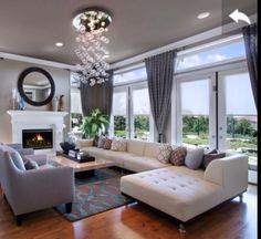 modern living room contemporary feel love the chandelier