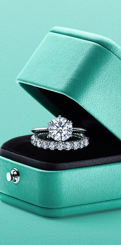 The Tiffany® Setting and Tiffany Embrace® rings in platinum.