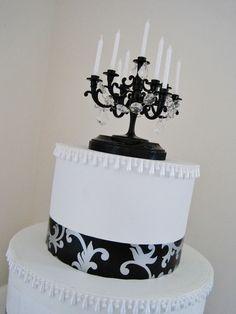 AMAZING Black Candelabra Wedding Cake Topper. $35.00, via Etsy.