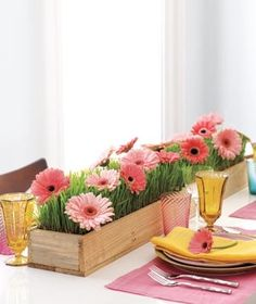 simple wooden boxes with grass and pink daisies - spring flower centerpieces, floral arrangements, decor ideas. For a spring display.