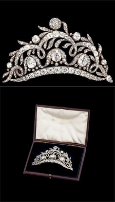 An old cut diamond tiara/brooch, tot. App. 20 cts, mid 19th century. Silver, the drop shaped diamonds are app. 1.70-2.00 cts. Later broochpin in gold, tiara stand and box. L 9.5 cm.