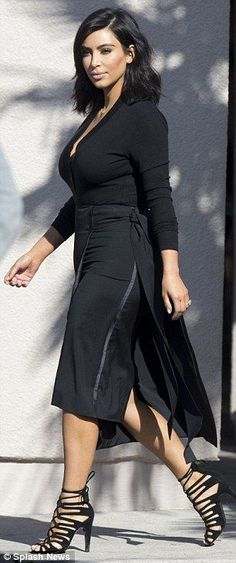 She spent her Friday morning sharing photos from another naked photo shoot, but you wouldn't have guessed it when Kim was seen later on, looking prim and proper