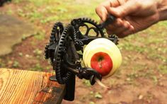 old apple peeler | An antique apple peeler makes short work of an apple's outer layer.