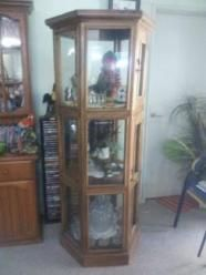 Quality sectagonal display cabinet, in excellent condition. 3 tiered with lockable doors. Regrettable sale. Height 1.8M by 78cm diameter.