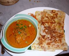 Roti Prata originates from Southern India and is a type of Indian pancake made of flour. It comes with a variation of fillings including egg, cheese, banana, onions, meat or even topped off with a scoop of ice cream. It is served with hot curry gravy. Some people prefer to eat it with sugar.    A Breakfast Favourite :)