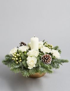 Buy the Festive White Candle Arrangement from Marks and Spencer's range. Christmas Door Decorations, Christmas Tablescapes, Christmas Centerpieces, Flower Decorations, Christmas Wreaths, Christmas Flower Arrangements, Candle Arrangements, Christmas Flowers, Floral Arrangements
