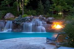 21 Ideas Of Outdoor Swimming Pool Designs With Incredible Waterfalls - Interior Design Inspirations Swimming Pool Waterfall, Outdoor Swimming Pool, Luxury Swimming Pools, Swimming Pool Designs, Over The Top, Lagoon Pool, Waterfall Features, Pool Builders, Cool Pools
