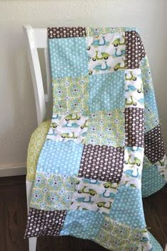 monaluna: simple baby quilt tutorial - This quilt is birthed and tied rather than quilted and bound, making it as easy as it can be!