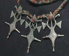 "Mali - Vintage Tuareg Crosses - Mid 20th century. Silver, wool. Each cross is cm. 7,7 x 4,5 (3.03"" x 1.77""); gr 32,9 (1.16 oz)"
