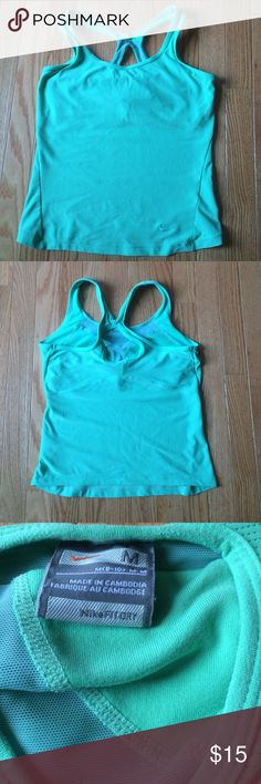 """💠new listing💠 Nike Dri Fit Yoga Top Nike Dry Fit Yoga too in a mint or sea foam green. Racer back strap, built in lined cup bra. gently used. there is a nickel sizes area of pulling on the front as shown in pic #4. best color representation in pic #4. Top of strap to hem line 21"""", pit to pit unstretched  15"""". Nike Tops Tank Tops"""