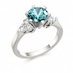 Engagement Ring.... I think I could do without the big diamond for a larger turquoise stone!!!!
