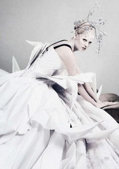 deprincessed: Lara Stone wears Christian Dior Haute Couture S/S 2007 off-white embroidered silk-gazar wedding dress with origami peaks and a cherry blossom headpiece in 'White Light White Heat' shot by Mario Testino for Vogue UK May 2007 'Abandon nostalgia and embrace new elegant whitewashed couture. It's a modern fashion love affair.'