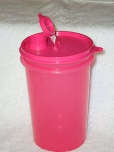 Tupperware MEGA 36 oz BEVERAGE TUMBLER Punch Pink by Tupperware. $16.00. 36 oz capacity.. Punch Pink in color.. Dishwasher Safe.. Seal and flip-open drink spout is virtually liquid-tight.. Tupperware MEGA 36 oz BEVERAGE TUMBLER Punch Pink