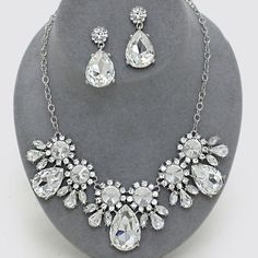 "HP Crystal Faceted Teardrop Sunflower Necklace • Color : Clear, Rhodium • Theme : Flower & Leaf  • Necklace Size : 17"" + 3"" L • Charm Size : 1 1/2"" L • Earring Size : 1 5/8"" L • Crystal Faceted Teardrop Sunflower Necklace • Rhinestone Faceted Sunflower Necklace NYC Chic Accessories Jewelry Necklaces"