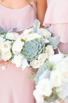 Four Seasons Scottsdale wedding, in blush and navy, with a Tara LaTour navy wedding gown. Florals are in white with beautiful succulents.  Bridesmaids in long blush dresses.