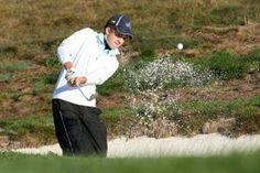 PEBBLE BEACH, CA - SEPTEMBER 27: Junior First Tee player Ian Buchanan hits out of a bunker on the first hole durng the first round of the Nature Valley First Tee Open at Pebble Beach at Pebble Beach Golf Links on September 27, 2013 in Pebble Beach, California. - Stephen Dunn/Getty Images