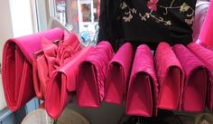 Just a few of our selection of Fuchsia clutches.