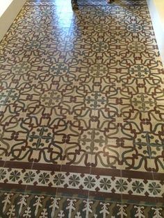 Intricate tile floor design in Gaudi's home in Park Guell.