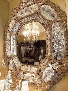 The dining room in Coco Chanel's Paris apartment, features two massive natural, carved rock crystal framed mirrors, sparkling behind rock crystal lamps, as they reflect a stunning rock crystal chandelier over her dining table. Chanel believed strongly in the healing & protective power of natural quartz. #rock_crystal #coco_chanel #coco #chanel