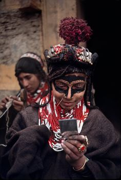 Kalashi girl adorns herself by painting her face before the Joshi spring festival | Chitral Northern Pakistan