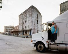 Joel Sternfeld A Man Stepping into the Cab of His Truck, The Bottoms, Kansas City, Missouri, June 1999 Stranger Passing