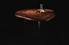 Handmade Parota wood slab table with metal legs by OSTROLUCKY