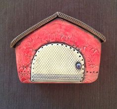 Hey, I found this really awesome Etsy listing at http://www.etsy.com/listing/150717305/red-ceramic-house-wall-sculpture