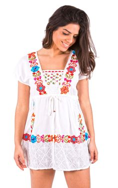 Savage Culture: Free-Spirited Embroidered Peasant Pull-Tie Tunic Ariadna, $87.00. A mixture of floral embroidery and tassel ties creates a floaty and free-spirited peasant tunic with tulip cap sleeves in luxuriously soft Cotton! Only WC!