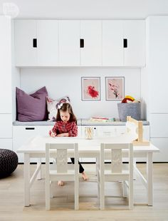 Kid's studio—In lieu of a tiny kids' desk, a large coffee table offers more space to spread out. The massive dispenser on top offers all the art paper an imaginative child could hope for. Tour the rest of the home here.