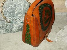 Shoulder bag with flaming cauldron and knotwork in green.