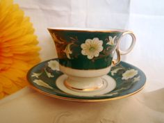 Beautiful porcelain cup and saucer . Classic set for tea. Green and yellow are the main colors. In excellent condition and without repairs.