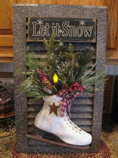 A shutter, window frame, or picture frame with skates filled with greens and a sign