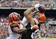 Cleveland Browns tight end Jordan Cameron makes a leaping catch on a 2-yard touchdown pass against Cincinnati Bengals strong safety Taylor M...