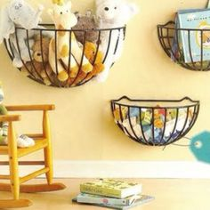 Hanging planters at a reachable arms length for little ones' toys! Must do this in Logan's nursery! Space saver!!!!