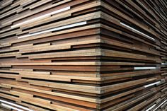 I love wooden slat walls.  I want to do one of these in my house SO bad.