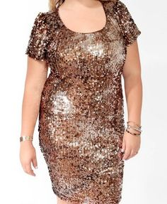 The model looks so uncomfortable... probably because she knows I just bought this for NYE and I rock it WAY better than her ;).  Sparkling Paillettes Dress | FOREVER21 PLUS - 2025101913