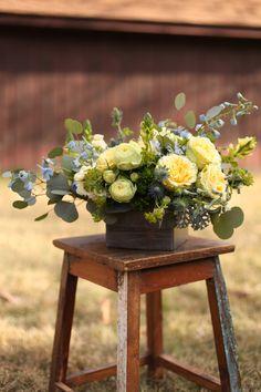 Centerpiece with bella donna delphinium, blue thistle, round leaf eucalyptus, dusty miller, green trachelium, bupleurum, Yellow Finesse rose...
