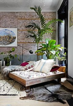 Originally built in the 1830′s, this Tribeca loft renovation has managed to retain some of the original features, the beautiful pressed tin ceilings (used as a feature wall in the bedroom), exposed br