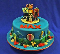 A chocolate mud cake filled with choc ganache and iced with fondant, with fondant ocean decorations and Octonaut figurine topper.