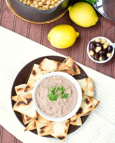 From-Scratch Kalamata Olive Hummus with Homemade Pita Chips: This classic from-scratch hummus recipe gets a blast of rich salty flavor from kalamata olives and freshness from parsley. The pita chips are quickly toasted in a skillet so that you can make them anytime, even on short notice. Recipe developed by @cookthestory