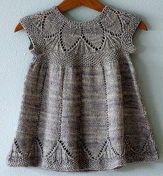 Precious knitted baby dress. Clara pattern by Karin Vestergaard Mathiesen, knit by Alicia Paulson.
