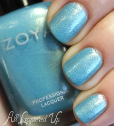 Zoya: Rebel  ... from Spring 2014 Awaken collection ...a cool, Caribbean blue metallic with silver and gold shimmer