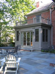 slate and brick patio, raised stone patio Glencoe Private Residence 2 - traditional - exterior - chicago - COOK ARCHITECTURAL Design Studio Traditional Exterior, Modern Exterior, Exterior Design, Exterior Houses, Exterior Trim, Cafe Exterior, Modern Roofing, Stucco Exterior, Exterior Paint Colors For House