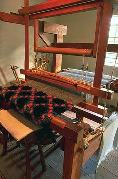 A copy of a bed rug found in Virginia's Wythe County is a work in progress on the weaver's loom.